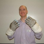 Me wearing Jim Lovell's gloves